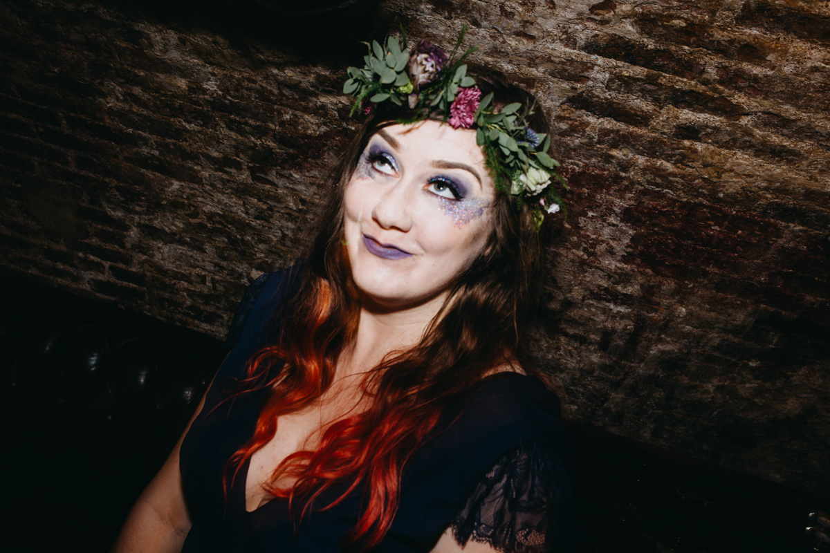 bridesmaid with kat von d glitter make up and red hair dancing at tempest inn wedding brighton