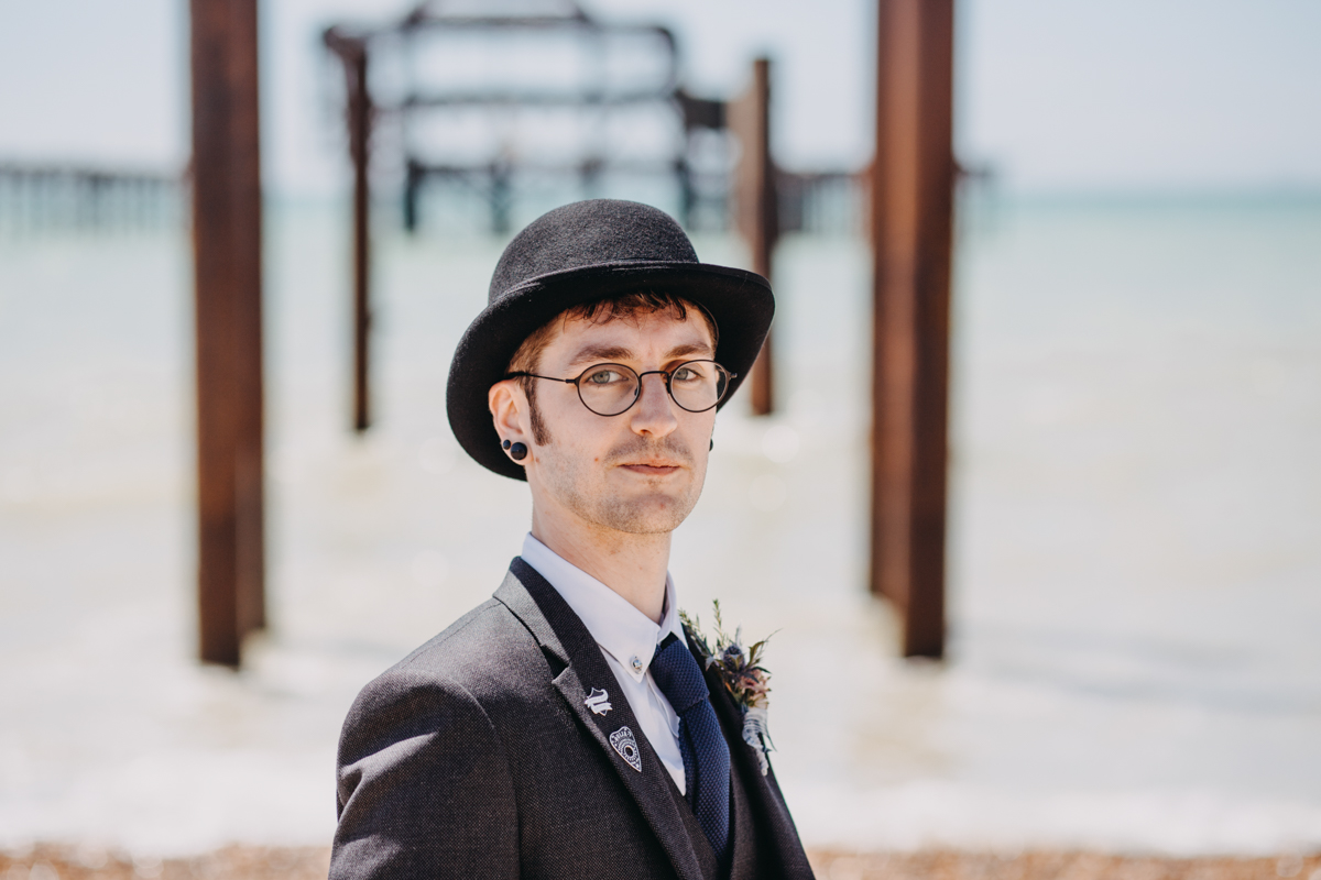 groom wearing bowler hat