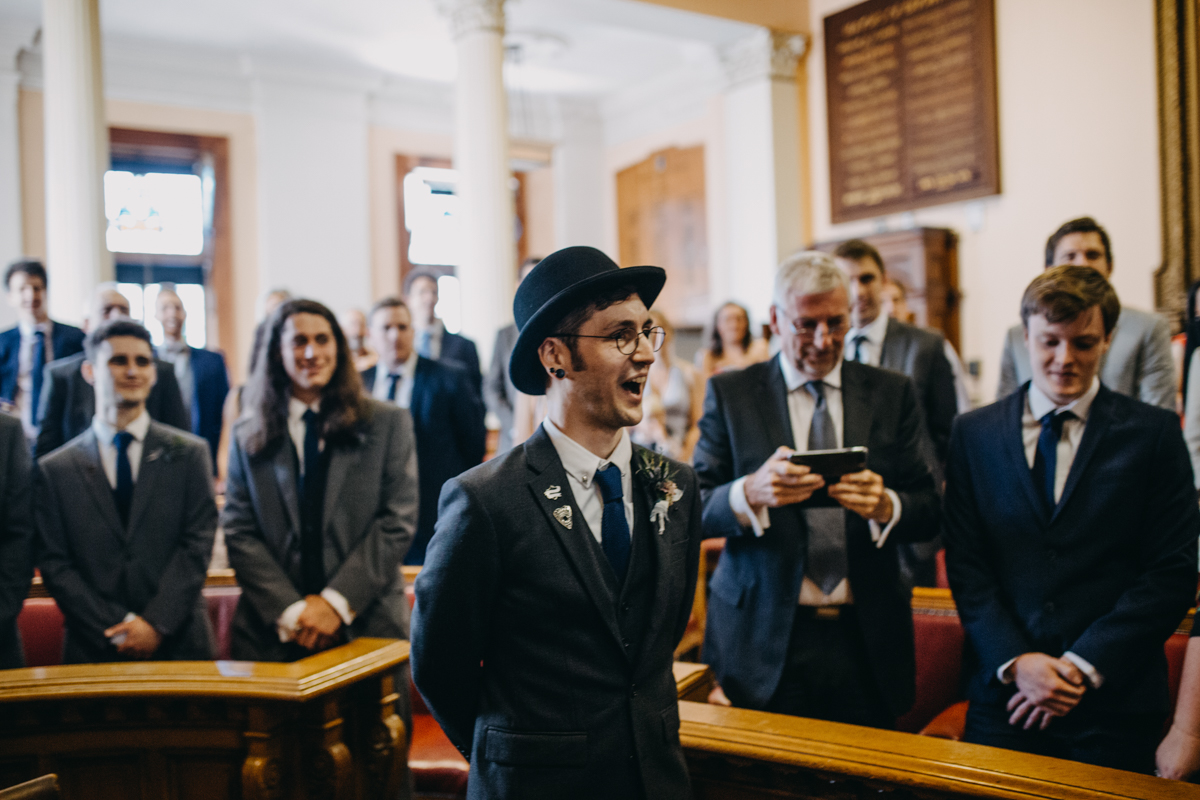 groom in bowler hat during wedding ceremony brighton town hall