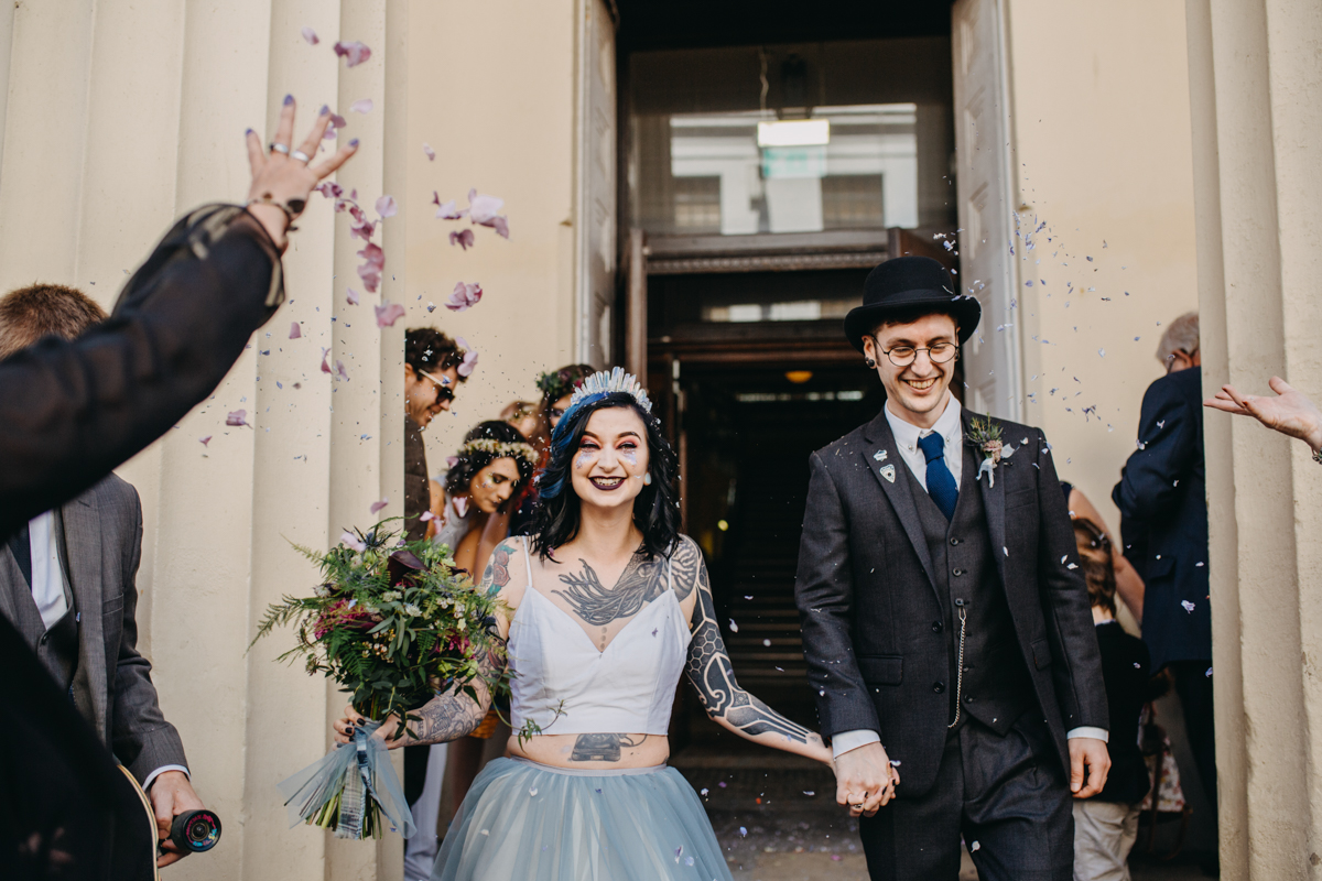 alternative bride and groom in confetti aisle at brighton wedding