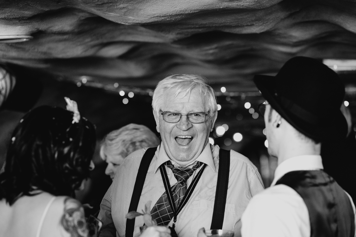 black and white candid wedding photography of guests brighton