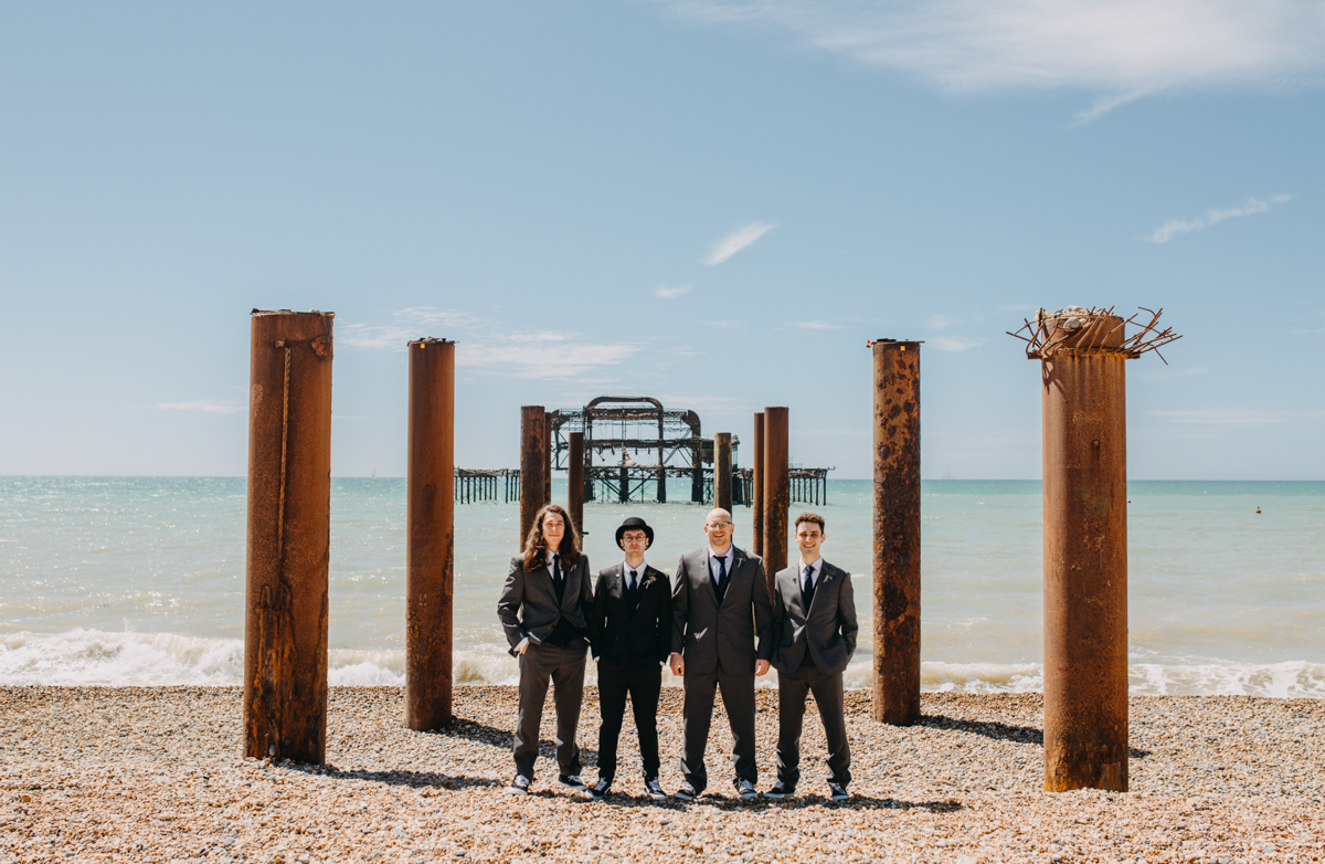 groom and ushers by west pier in Brighton
